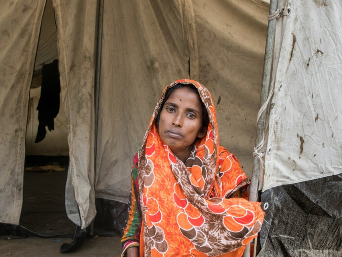 woman sitting outside tent