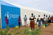 Photo: WFP/ Photogallery, Refugees wait to collect food at a centre in Kakuma camps